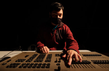 """Lighting Designer Forrest Tallbull at the lighting control console during """"From the Fishbowl"""""""