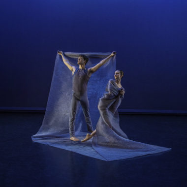 Photo by Ed Flores featuring UA Dance Ensemble members Candice Barth and Gregory Taylor in Among the Stars by Jessica Lang
